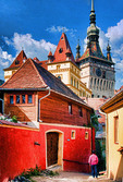 Romania: Residential lane in medieval citadel town of Sighisoara (Schassburg in German), with clock tower above, in Transylvania region.