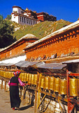 Lhasa, Tibet, China:  Prayer wheels being turned by pilgrim circumambulating the Potala Palace.