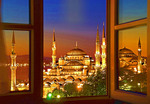 Sultan Ahmet Mosque (Blue Mosque) from hotel window at dawn with Aya Sofya reflected in window pane at right, Istanbul, Turkey