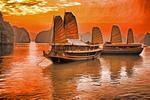 Tourist junks at sunset on Halong Bay, Vietnam