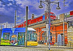 Berlin transit hub with street tram and S-bahn train above.