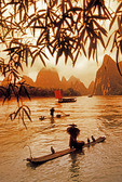 Li River cormorant fishermen on bamboo rafts near Xingping in Guangxi, China