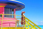 Woman in red on lifeguard station on South Miami Beach.  PHOTO ART PAINTING