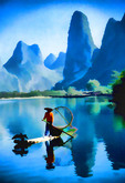Li River, Guangxi, China: Young cormorant fisherman on river near Xingping (Guilin area).