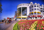 Grand Hotel with tulips amd carriage on Mackinac Island, Michigan.
