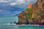 Italy: Cinque Terre National Park, rocky cliff at Manarola on Ligurian Coast of Mediterranean Sea.
