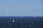 Wind turbines and sailboat near Copenhagen, Denmark.