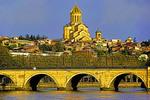 Holy Trinity (Sameba) Cathedral of Tblisi and Dry Bridge on Mtkvari River.