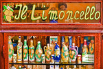 Italy: Window of shop specializing in Limoncello, locally made lemon liqueur, in village of Amalfi on Amalfi Coast.