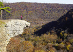 Hiker on Hawksbill Crag at Whittaker Point in the Upper Buffalo Wilderness Area of the Ozark Mountains.