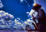New Orleans Jazzman on Mississippi River levee.