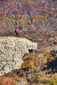 Hiker on Hawksbill Crag in autumn at Whittiker Point in Upper Buffalo Wilderness Area of Ozark Mountains in Arkansas.