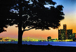 Detroit, Michigan, from Belle Isle Park in the Detroit River with lights of Ambassador Bridge to Canada and Renaissance Center in downtown.