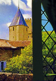 View from luxury suite in Hotel de la Cite, a UNESCO World Heritage site, of garden and medieval citadel's turret in Carcassone, France.