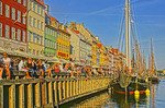 Nyhavn crowd on summer day in Copenhagen, Denmark.