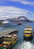 Sydney Harbour's Circular Quay with Sydney Ferries and Carnival Legend cruise ship.