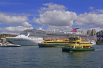 Carnival Legand cruise ship and Sydney Ferries in Sydney Harbour.