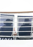 Cruise ship passengers relaxing on deck.