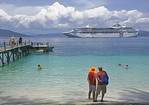 Couple from Sea Princess cruise ship on beach at Doini Island, Papua New Guinea.