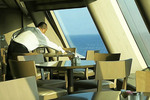 Horizon Court buffet dining room attendant cleaning tables before breakfast on Sea Princess cruise ship.