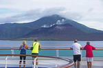 Sea Princess cruise ship passing active volcano on New Britain Island, Papua New Guinea.