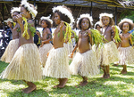 Melanesian girls in tribal festival dress dancing at Alotau, Papua New Guinea.