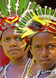 Melanesian young men in tribal festival dress at Alotau, Papua New Guinea.