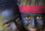 Melanesian boys in tribal festival dress and face paint at Alotau, Papua New Guinea.