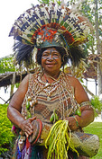 Melanesian woman in tribal festival dress at Alotau, Papua New Guinea.