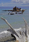 Beach on Guadalcanal with wreckage of WWII U.S. military landing craft rusting in Iron Bottom Sound.