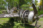 Wreckage of American Grumman Wildcat fighter plane in outdoor Vilu War Museum, Guadalcanal, Solomon Islands.