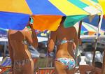 Bikinis at Khai Nok Island Beach in Phuket Bay, Thailand.