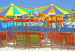 Umbrellas and chairs at Khai Nok Island Beach in Phuket Bay, Thailand.