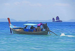 Long-tail boat on the Andaman Sea near Phuket Bay, Thailand.