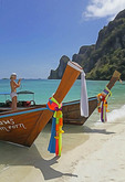 Long-tail boat photographer at Ton Sai Bay on Phi Phi Don Island, Thailand.