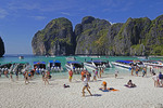 Maya Bay, crowded with tourists and tour boats, Phi Phi Leh Island, Thailand.
