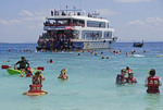 Large cruise boat with passengers snorkeling at Phi Phi Don island, Phuket Bay, Thailand.