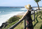 Woman at Lennox Head overlook, NSW, Australia.