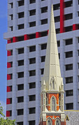 Architecture of Albert Street Congregation Church contrasts with modern Suncorp Building in Brisbane.