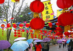 Chinese lanterns and flags decorating street in Jing Gong Ancient Village near Changsha, Hunan, China