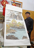 93-year-old Chinese retiree with his prize winning traditional landscape painting in his Changsha apartment.