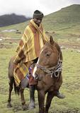 Basotho horseman wearing Mohair blanket in Lesotho.