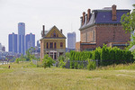 Detroit Brush Park's remaining Victorian houses and vacant lots with downtown Reniassance Center in distance.