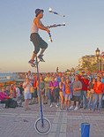 Juggler in Key West's Mallory Square entertaining tourists at sunset.