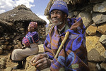 Elderly Basotho couple by their rondavels at Sani Pass in Lesotho
