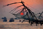 Cantilevered Chinese fishing nets at sunset at Cochin (Kochi) on Malabar coast of Arabian Sea in Kerala, India.