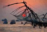 Cantilevered Chinese fishing nets at sunset at Cochin (Kochi) on Malabar coast of Arabian Sea in Kerala, India.