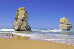 Children playing on 12 Apostles Beach on Great Ocean Road, Victoria, Australia.
