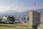 Overview of city of Skopje with wall and watch tower of Skopje Fortress.
