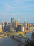 Pittsburgh, Pennsylvania, downtown skyline with highway bridge over Monongahela River.